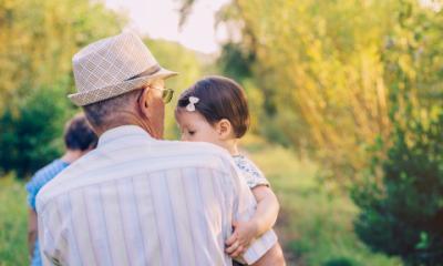grandfather holding grandchildren
